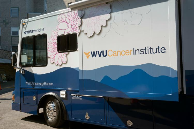 Bonnie's Bus is a mobile mammography unit that the WVU Cancer Institute uses to conduct breast cancer screenings across West Virginia, even in rural counties that aren't near a conventional medical imaging facility. WVU researchers Stephenie Kennedy-Rea and Richard Goldberg are investigating whether a new colorectal-cancer-screening method, which involves a simple blood test, can broaden the cancer-screening options that units like Bonnie's Bus offer. (Credit: WVU)